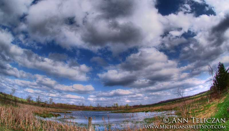 Beautiful cloudy blue sky in Michigan by Ann Teliczan